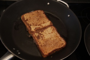 Two French toasts in pan