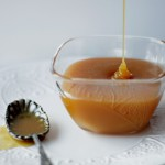 caramel sauce drizzling into small glass bowl