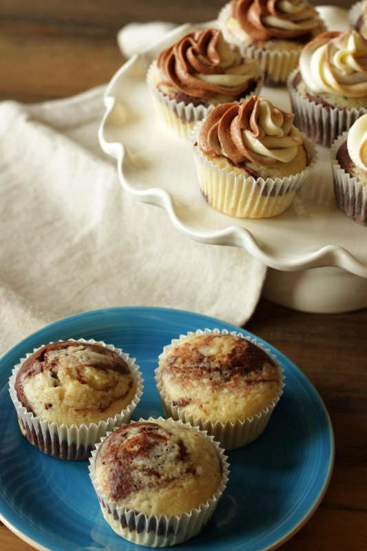 These chocolate and vanilla marbled cupcakes are cute and fun yet so easy to make. The cupcakes themselves are tender and moist. The swirled chocolate and vanilla cream cheese frosting on top is the best! Try this recipe for your next celebration!