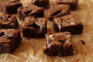 Salted Caramel Brownies on brown parchment paper