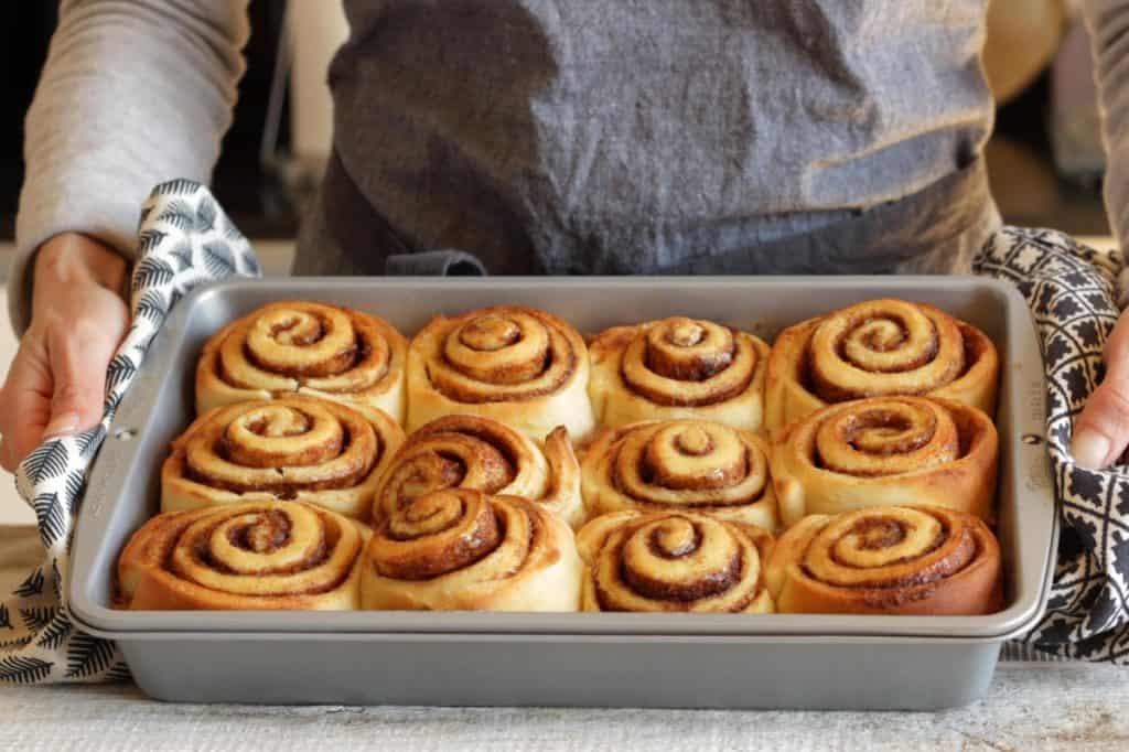 freshly baked cinnamon rolls in pan