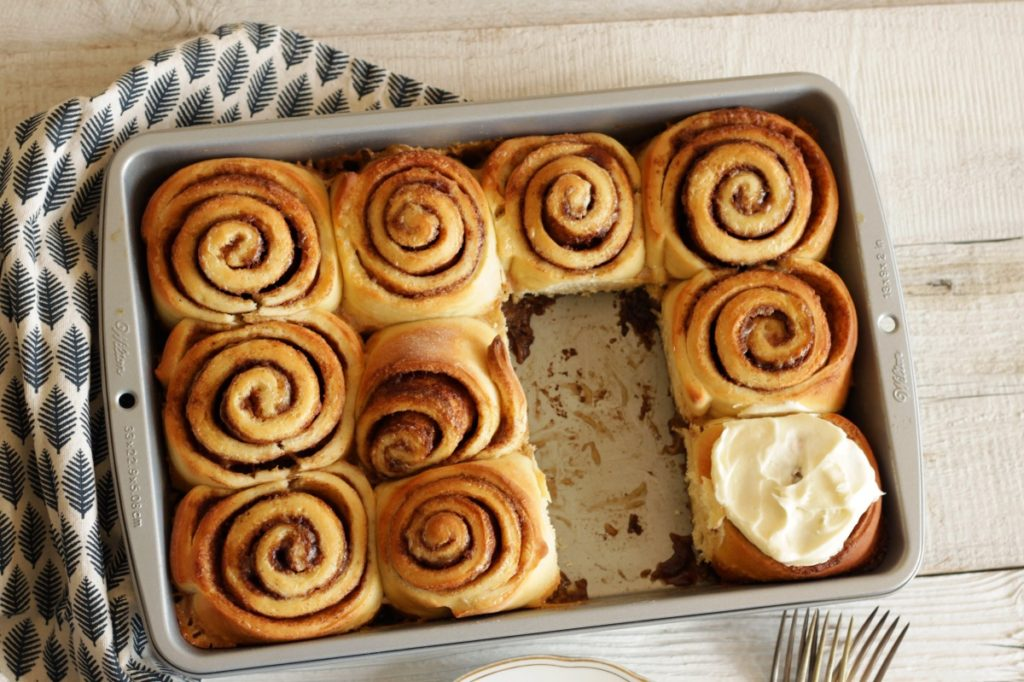 cinnamon rolls in pan, two are missing