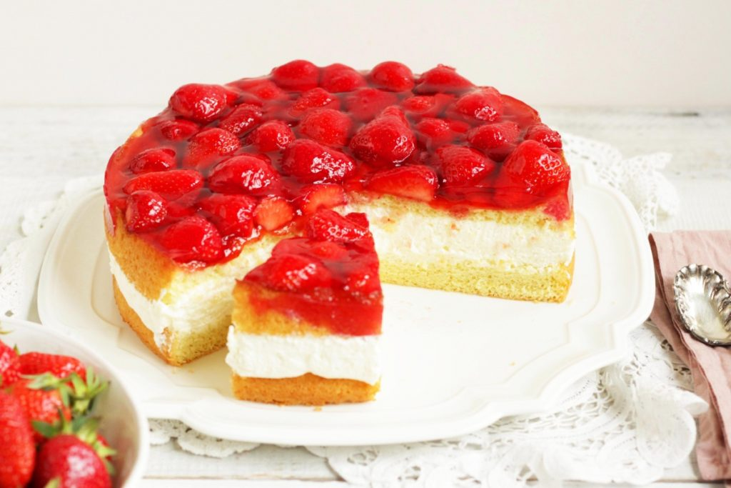 This beautiful torte consists of a fluffy, no-fail sponge cake, a divine topfen cream filling and glazed fresh strawberries. Topfen Torte with Strawberries is an elegant, classic Austrian cake. This is a must-try recipe!